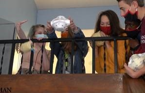 Students dropping eggs in Styrofoam containers
